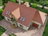 Проект большого коттеджа с шестью спальнями и гаражом