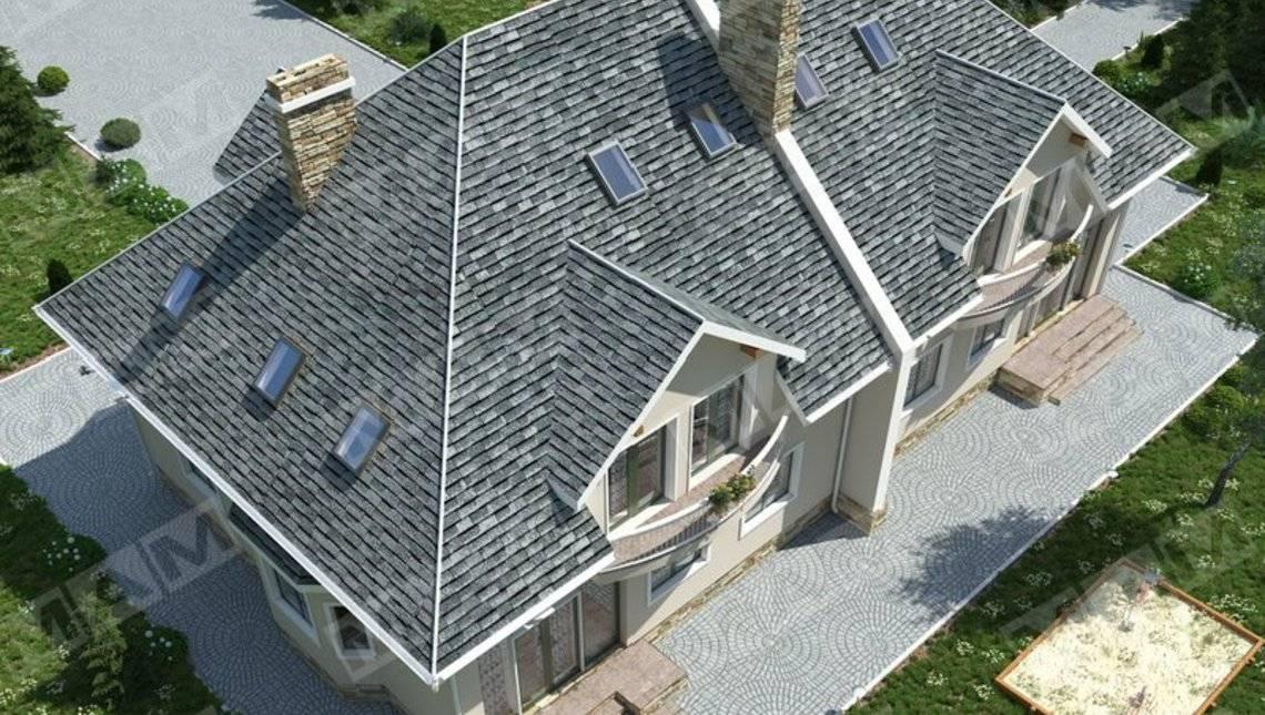 Интересный проект просторного загородного дома на две семьи с гаражами